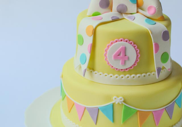 Pretty yellow bunting cake close up